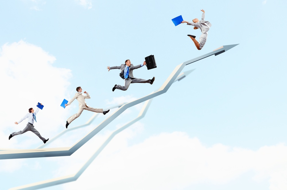 Young businesspeople jumping on white arrows. Growth concept.jpeg