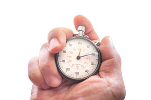 bigstock-Hand-Holding-A-Stopwatch-Isola-332649499