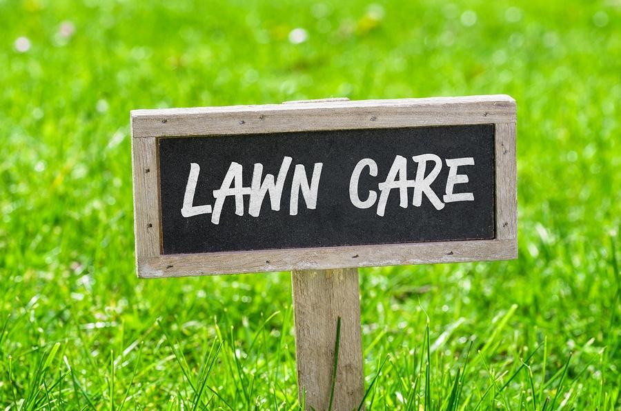 bigstock-Sign-On-A-Green-Lawn--Lawn-Ca-127929566.jpg