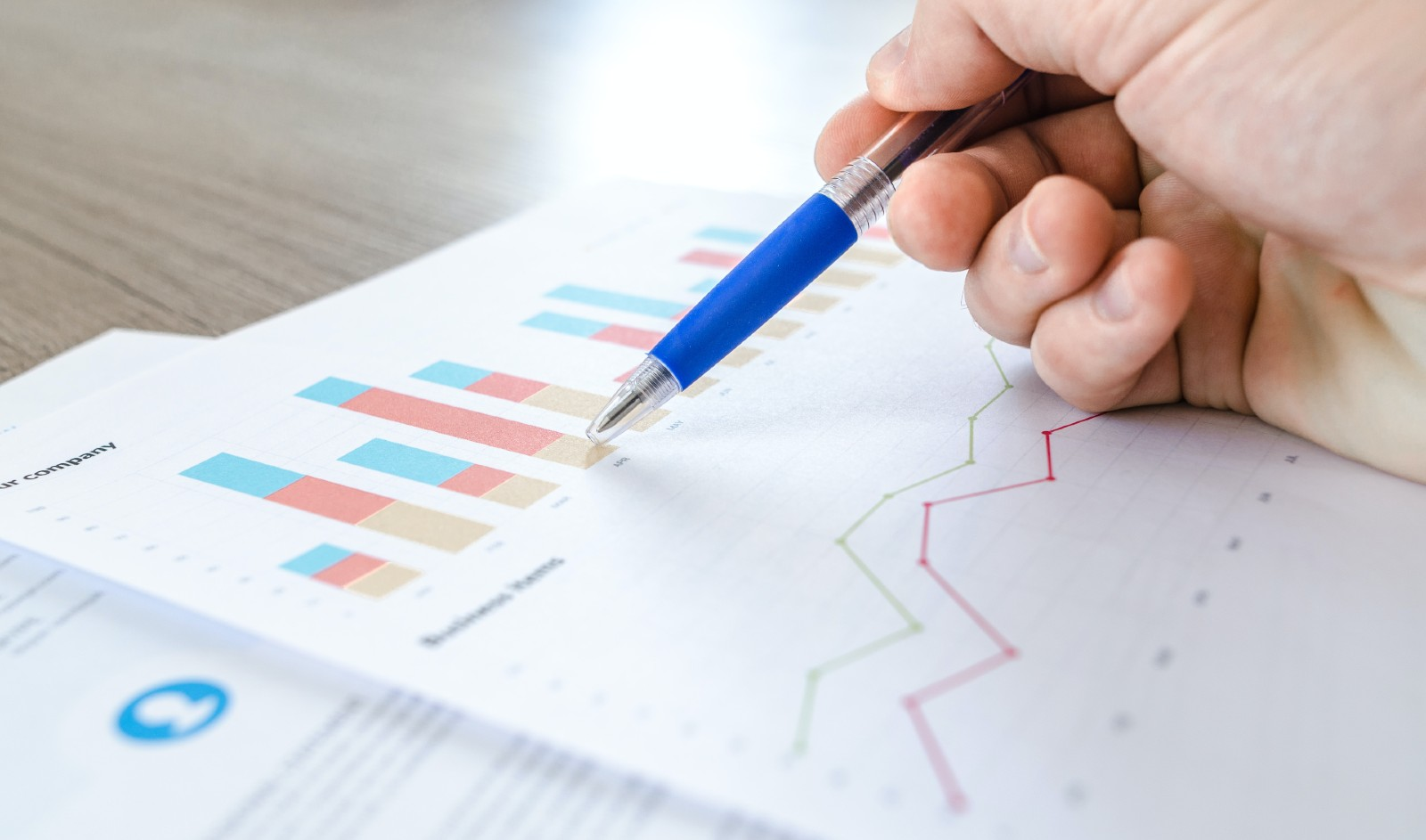 Digital marketer studying chart with data